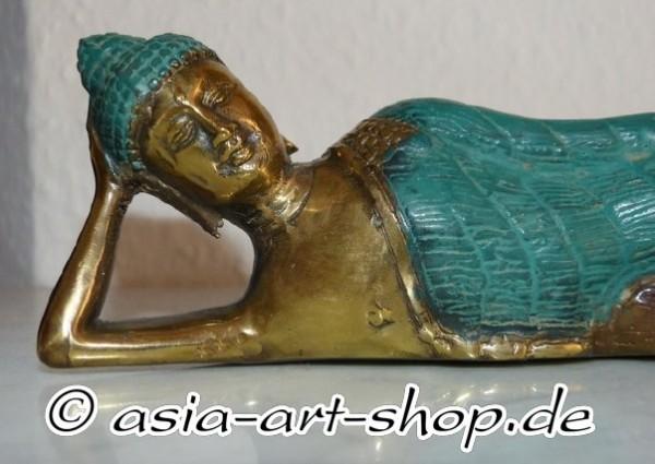Bouddha en bronze allongé
