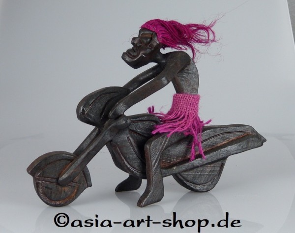 Asmat on motorcycle